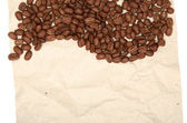 Coffee beans on a old paper background — Stock Photo