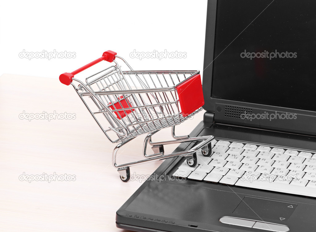Online shopping. trolley on laptop isolated on white — Stock Photo #10925801