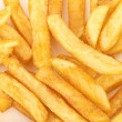 A pile of french fries on a white background — Stock Photo