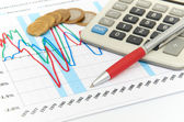 Calculator, coins and pen laying on chart. Concept of finance. — Stock Photo