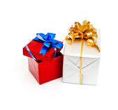 Gift box with gold bow isolated on white — Stock Photo