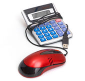 Calculator and computer mouse — Stock Photo
