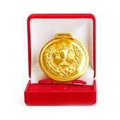 Golden medal in red gift box. white background — Stock Photo