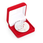 Silver medal in red gift box. white background — Stock Photo