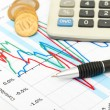 Calculator, coins and pen laying on chart. Concept of finance. — Stock Photo #11062713