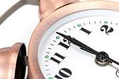 Bronze vintage alarm clock isolated on white background — Stock Photo