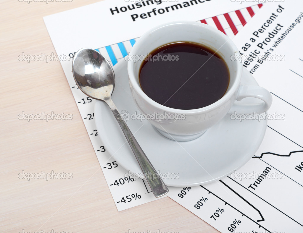 Accounting. Cup of coffee on document. chart and diagram — Stock Photo #11061053