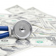 Stethoscope and dollars illustrating expensive healthcare — Stock Photo