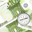 Many euro bank notes and a compass lie side by side — Stock Photo #11349270