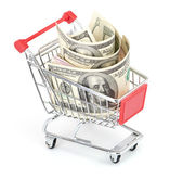 Shopping cart and dollars on the white — Stock Photo
