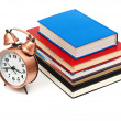 Stock Photo: Clock and books on white background