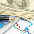 Pen,calculator and dollars on chart closeup. Business concept — Stock Photo #11390550