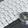 Computer keyboard and retro compass, business decision — Stock Photo