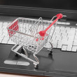 Online shopping. trolley on laptop — Foto de Stock