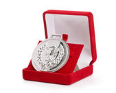 Silver medal in red gift box. — Stock Photo