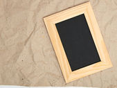 Wooden frame on old paper — Stock Photo