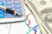 Pen,calculator and dollars on chart closeup — Stok fotoğraf