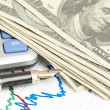 Pen,calculator and dollars on chart closeup — Stock Photo #12244058