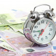 Alarm clock for euro banknotes — Stockfoto