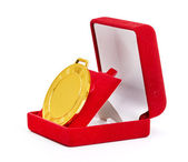 Golden medal in red gift box. — Stock Photo