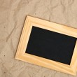 Wooden frame on old paper — Stock Photo #12413529