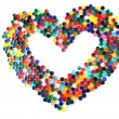 Heart from the color plastic caps — Stock Photo