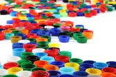 Plastic color caps background — Stock Photo