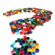 Question symbol from color caps — Stock Photo #11959273