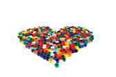 Heart from color caps — Stock Photo
