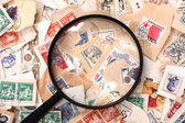 Postage stamp and magnify glass — Stock Photo