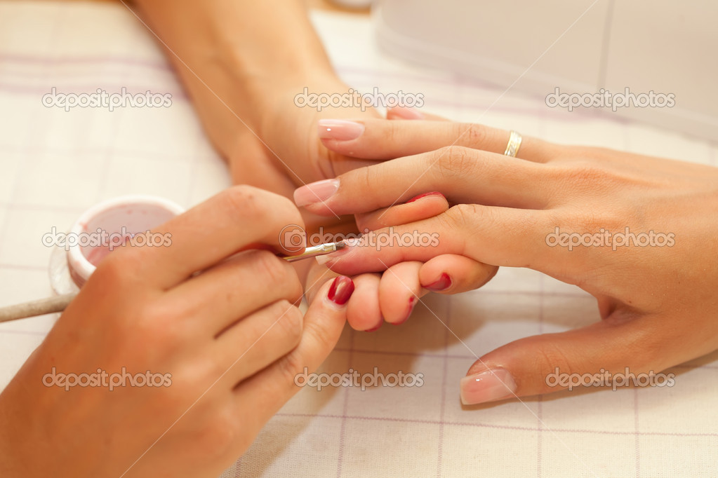 A woman is getting manicure. Soft focus. — Stock Photo #11657487