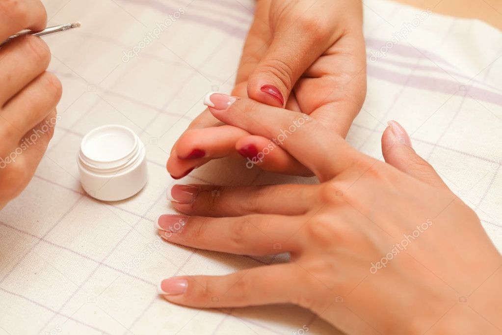 French manicure. A woman is getting manicure. Soft, selective focus. Fingers. — Stock Photo #11657514