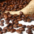 Coffee beans and burlap bag — Stockfoto
