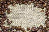 Coffee beans on burlap — Стоковое фото