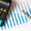 Chart with calculator and pen — Stock Photo #11347108
