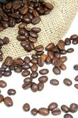 Coffee beans and burlap bag — Stock Photo