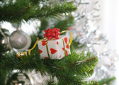 Gift on christmas tree — Stock Photo