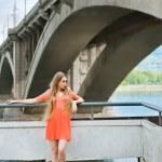 Young woman near the bridge — Stock Photo #10973324