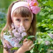 Girl near the lilac bushes — Stock Photo #11213073