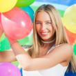 Girl with balloons — Stock Photo #11213356