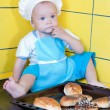 The kid chef with biscuits — Stock Photo