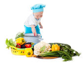 Baby Chef and vegetables — Stock Photo