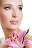 Beautiful girl with a flower lily — Stock Photo
