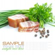 Pieces of bacon are with the bunch of green parsley and by grains of pepper on a white background — Stock Photo #11423336