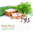 Pieces of bacon are with the bunch of green parsley and by grains of pepper on a white background — Stock Photo