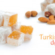 Turkish delight (lokum) with nuts on white background — Stock Photo