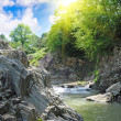 Stock Photo: Tranquil waterfall with rocks by summer