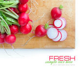 Fresh radish on a wooden board on white background — Stock Photo