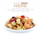 Mix nuts and dry fruits on a white background — Stock Photo