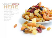 Mix nuts and dry fruits on a white background — Foto de Stock